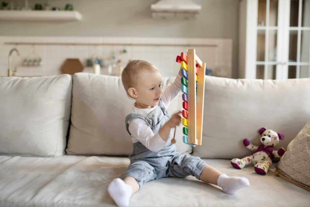 cute-little-baby-girl-playing-with-xylophone-LMFBV7C