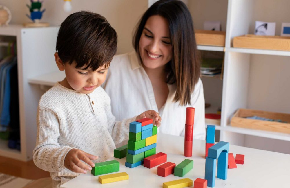 preschooler-kid-playing-with-wood-blocks-and-teach-G5MFR9V